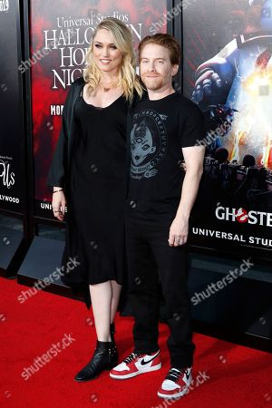 Stock Photo of Clare Grant with US actor Seth Green at the opening celebration for Halloween Horror Nights at Universal Studios Hollywood in Los Angeles, California, USA 12 September 2019.