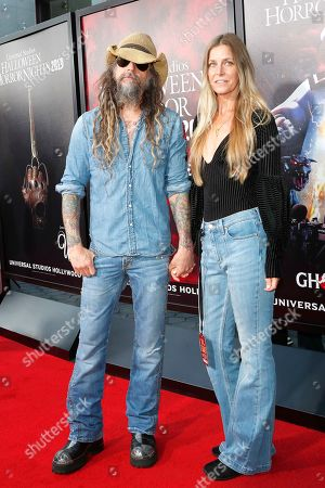 US musician and filmmaker with wife US actress, Rob Zombie, Sheri Moon Zombie at the opening celebration for Halloween Horror Nights at Universal Studios Hollywood in Los Angeles, California, USA 12 September 2019.