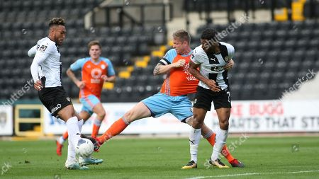 Kyle Wootton and Wes Thomas look to battle past Halifax captain Nathan Clarke.