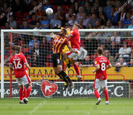 Liam Roberts of Walsall punches clear ahead of Ben Richards-Everton of Bradford City with Dan Scarr of Walsall supporting during the Sky Bet  League Two match  Walsall v Bradford City  at The Bank's Stadium, Walsall, West Midlands, UK 14/09/2019