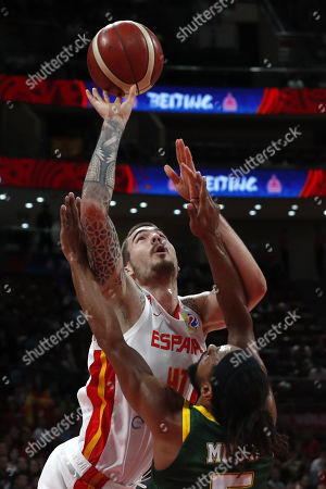 Stock Photo of Juancho Hernangomez of Spain (L) in action against Patty Mills of Australia during the FIBA Basketball World Cup 2019 semi-final match between Spain and Australia in Beijing, China, 13 September 2019.