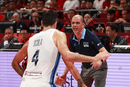 Argentina's head coach Sergio Hernandez (R) reacts during the FIBA Basketball World Cup 2019 semi final match between Argentina and France in Beijing, China, 13 September 2019.