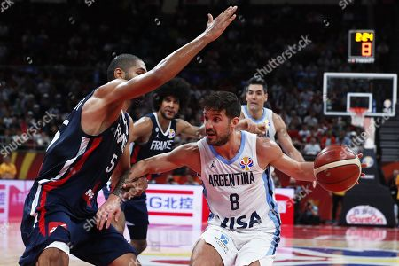 Nicolas Laprovittola (R) of Argentina in action against Nicolas Batum (L) of France during the FIBA Basketball World Cup 2019 semi final match between Argentina and France in Beijing, China, 13 September 2019.