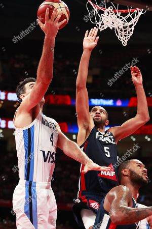 Luis Scola (L) of Argentina in action against Nicolas Batum (C) of France during the FIBA Basketball World Cup 2019 semi final match between Argentina and France in Beijing, China, 13 September 2019.