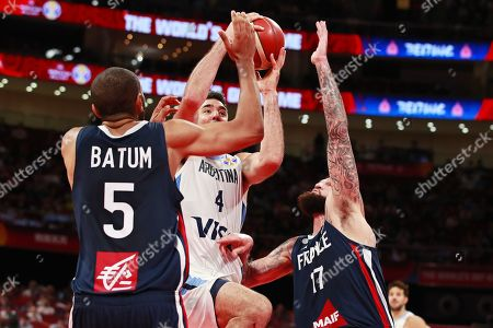 Luis Scola (C) of Argentina in action against French players Nicolas Batum (L) and Vincent Poirier (R) during the FIBA Basketball World Cup 2019 semi final match between Argentina and France in Beijing, China, 13 September 2019.