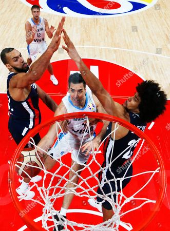 Luis Scola (C) of Argentina in action against French players Nicolas Batum (L) and Louis Labeyrie (R) during FIBA Basketball World Cup 2019 semi final match between Argentina and France in Beijing, China, 13 September 2019.