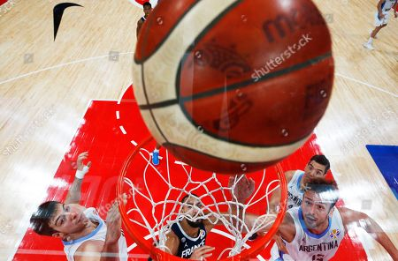 Marcos Delia (R) of Argentina in action against Nicolas Batum (C) of France during the FIBA Basketball World Cup 2019 semi final match between Argentina and France in Beijing, China, 13 September 2019.