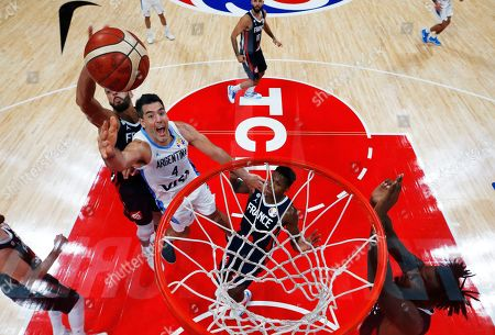 Luis Scola (2-L) of Argentina in action against Nicolas Batum (L) of France during the FIBA Basketball World Cup 2019 semi final match between Argentina and France in Beijing, China, 13 September 2019.