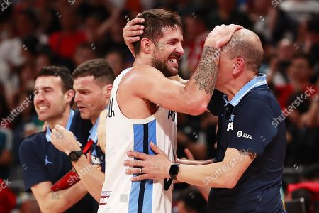 Argentina's head coach Sergio Hernandez (R) celebrates with Nicolas Laprovittola (2-R) after winning the FIBA Basketball World Cup 2019 semi final match between Argentina and France in Beijing, China, 13 September 2019.