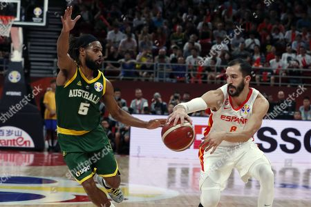 Pau Ribas of Spain (R) in action against Patty Mills of Australia during the FIBA Basketball World Cup 2019 semi-final match between Spain and Australia in Beijing, China, 13 September 2019.