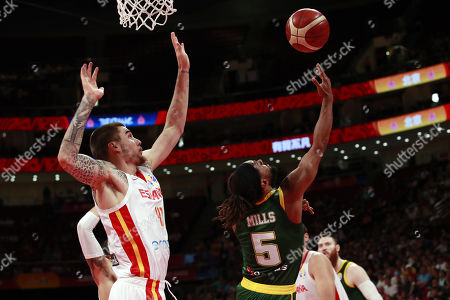 Stock Image of Juancho Hernangomez of Spain (L) in action against Patty Mills of Australia (R) during the FIBA Basketball World Cup 2019 semi-final match between Spain and Australia in Beijing, China, 13 September 2019.