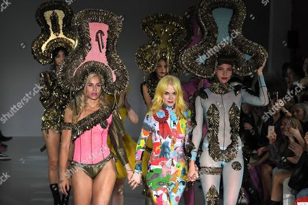 Designer Pam Hogg and Alice Dellal on the catwalk