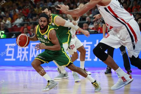 Patty Mills of Australia (L) in action during  the FIBA Basketball World Cup 2019 Third Place match between France and Australia in Beijing, China, 15 September 2019.