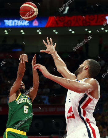 Patty Mills of Australia (L) in action against Rudy Gobert of France during the FIBA Basketball World Cup 2019 Third Place match between France and Australia in Beijing, China, 15 September 2019.