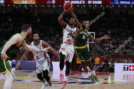 Andrew Albicy of France (2-R) in action against Patty Mills of Australia (R) during the FIBA Basketball World Cup 2019 Third Place match between France and Australia in Beijing, China, 15 September 2019.
