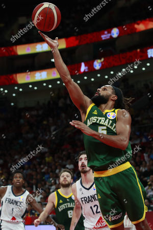 Patty Mills of Australia (R) in action during the FIBA Basketball World Cup 2019 Third Place match between France and Australia in Beijing, China, 15 September 2019.