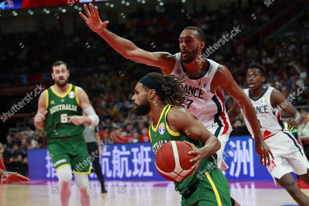Patty Mills of Australia (L) in action against Rudy Gobert (R) of France during the FIBA Basketball World Cup 2019 Third Place match between France and Australia in Beijing, China, 15 September 2019.