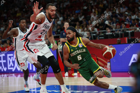 Rudy Gobert of France (L) in action against Patty Mills of Australia during the FIBA Basketball World Cup 2019 Third Place match between France and Australia in Beijing, China, 15 September 2019.