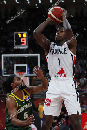 Frank Ntilikina of France (R) in action against Patty Mills of Australia during the FIBA Basketball World Cup 2019 Third Place match between France and Australia in Beijing, China, 15 September 2019.
