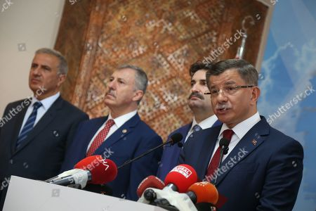 Turkey's former Prime Minister Ahmet Davutoglu (R) speaks during a press conference in Ankara, Turkey 13 September 2019. Davutoglu announced that he is resigning from Turkey's ruling Jsutice and Development Party (AK Party).