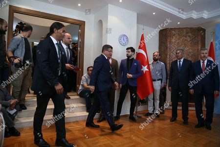 Turkey's former Prime Minister Ahmet Davutoglu (C) arrives for a press conference in Ankara, Turkey 13 September 2019. Davutoglu announced that he is resigning from Turkey's ruling Jsutice and Development Party (AK Party).