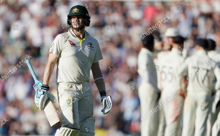 Australia's Steve Smith leaves the pitch after he is bowled lbw by England's Chris Woakes during the second day of the fifth Ashes test match between England and Australia at the Oval cricket ground in London