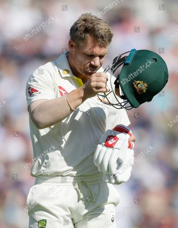 Australia's David Warner leaves the pitch after he is caught by England's Jonny Bairstow off the bowling of England's Jofra Archer during the second day of the fifth Ashes test match between England and Australia at the Oval cricket ground in London