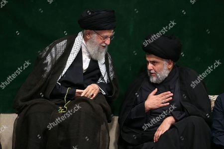 Iran's Supreme Leader Ayatollah Ali Khamenei (L) speaking with Iraqi Shiite cleric, politician, and militia leader Muqtada al-Sadr