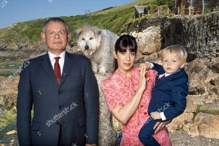 Martin Clunes as Doc Martin, Caroline Catz as Louisa and little James Henry.