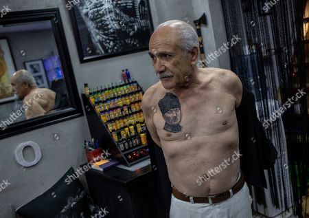 Turkish retiree Cahit Yilmaz shows his tattoo portrait of the founder of modern Turkey Mustafa Kemal Ataturk, symbolizing secularism, in Istanbul, Turkey, 13 May 2019. Yilmaz calls himself a social democrat. Turkey, a historically secular state, has undergone dramatic political changes in recent years, as President Erdogan, backed by a conservative Muslim and largely rural base, has tightened his grip on power. Multiple elections, constitutional referendums and massive popular protests based in Gezi Park and Taksim Square in 2014 have created a new generation of increasingly politicized Turks, especially in the capital city, Istanbul. These changes are reflected in popular culture, and political symbols and icons have become more prominent in the public sphere. This is also true for body art, with Turkish tattoo artists saying that the demand for political tattoos has also increased in recent years.