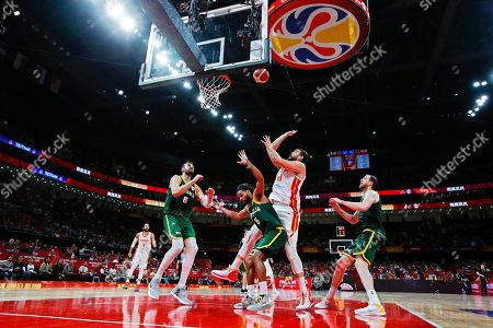 Marc Gasol (2-R) of Spain in action against Australian players (L-R) Andrew Bogut, Patty Mills, and Joe Ingles during the FIBA Basketball World Cup 2019 semi final match between Spain and Australia in Beijing, China, 13 September 2019.