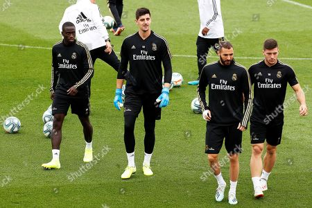 Real Madrid players (L-R) Ferland Mendy, goalkeeper Thibaut Courtois, Karim Benzema, and Luka Jovic attend their team's training session at the club's Valdebebas sports facility in Madrid, Spain, 13 September 2019. Real Madrid will face Levante UD in their Spanish La Liga soccer match on 14 September 2019.