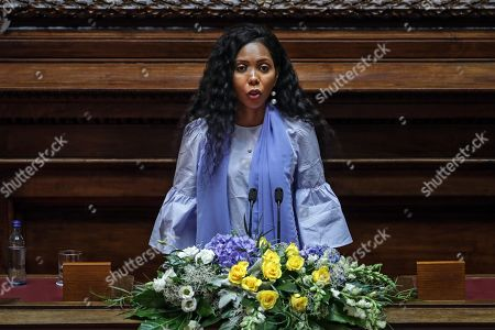 UN Women Goodwill Ambassador for Africa, Jaha Dukureh, delivers her speech after receiving the 2018 North-South Prize of the Council of Europe, at the Portuguese Parliament in Lisbon, Portugal, 13 September 2019. The annual prize is awarded by the North-South Centre of the Council of Europe to two public figures for their achievements in protection of human rights and defense of an pluralist democracy.