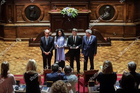 UN Women Goodwill Ambassador for Africa, Jaha Dukureh (2L), and European Parliament deputy, Damien Caremea (2R) accompanied by Portuguese President Marcelo Rebelo de Sousa (L) and Parliament President Eduardo Ferro Rodrigues (R) after they received the 2018 North-South Prize of the Council of Europe, at the Portuguese Parliament in Lisbon, Portugal, 13 September 2019. The annual prize is awarded by the North-South Centre of the Council of Europe to two public figures for their achievements in protection of human rights and defense of an pluralist democracy.