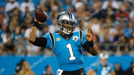 Carolina Panthers quarterback Cam Newton (1) passes against the Tampa Bay Buccaneers during the first half of an NFL football game in Charlotte, N.C