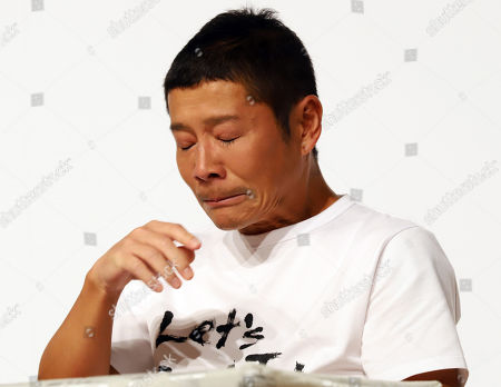 Stock Picture of Zozo founder Yusaku Maezawa holds back his tears as he announces Yahoo Japan will acquire Zozo at a press conference