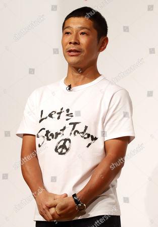 Zozo founder Yusaku Maezawa announces Yahoo Japan will acquire Zozo at a press conference