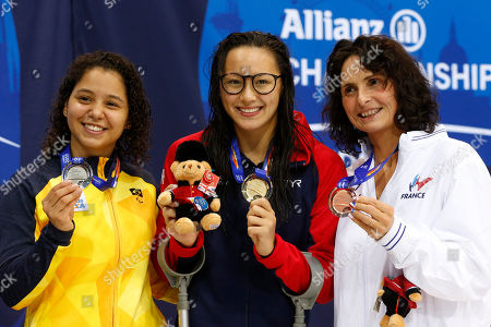 Stock Picture of (L-R) Cecilia Jeronimo de Araujo of Brazil, Alice Tai of Great Britain and Claire Supiot of France pose with their medals for Women's 50M Freestyle S8, on day five of the World Para Swimming Championships at the London Aquatics Centre in London, Britain, 13 September 2019. The event is one of the largest Para Swimming championships and will see nearly 600 swimmers compete from 09 September to 15 September 2019.