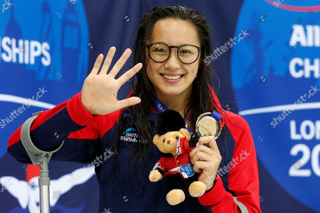 Alice Tai of Great Britain poses with her gold medal for Women's 50M Freestyle S8, on day five of the World Para Swimming Championships at the London Aquatics Centre in London, Britain, 13 September 2019. The event is one of the largest Para Swimming championships and will see nearly 600 swimmers compete from 09 September to 15 September 2019.