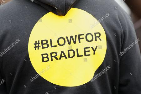 A Blow For Bradley logo on someone's top outside St John Lloyd School, in Llanelli