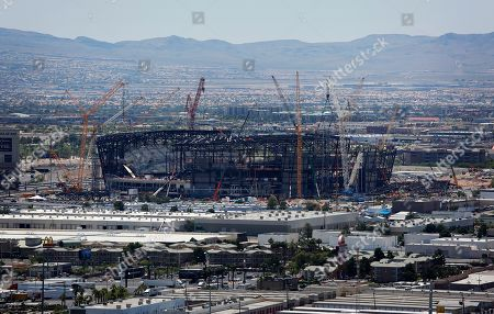 Construction cranes surround the football stadium under construction in Las Vegas. Hard to imagine now, but as recently as 15 years ago the NFL rejected Super Bowl advertising from Las Vegas tourism officials. As late as four years ago it forced organizers of a fantasy football convention in the gambling city to cancel their show because Dallas Cowboys quarterback Tony Romo was going to be a featured guest