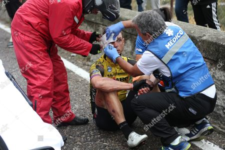 German rider Tony Martin of Jumbo-Visma team receives medical attention after falling during the 19th stage of the Vuelta a Espana cycling race over 165.2km from Avila to Toledo Spain, 13 September 2019.