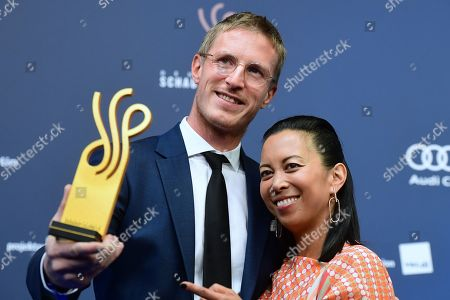 Stock Picture of German actor Golo Euler poses next to laudatory speaker, German actress Minh-Khai Phan-Thi, with his award in the category best male secondary role actor during the German Drama Award (Deutscher Schauspielpreis) in Berlin, Germany 13 September 2019.