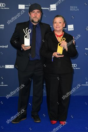 Stock Photo of Bjarne Maedel (L) and Ursula Werner pose with their awards in the category Comedy Role during the German Drama Award (Deutscher Schauspielpreis) in Berlin, Germany 13 September 2019.