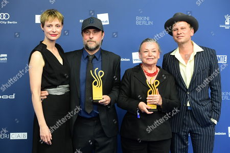 Stock Image of Bjarne Maedel (2-L) and Ursula Werner (3-L) pose with their awards next to laudatory speakers Katharina Schubert (L) and Robert Stadlober (R) in the category Comedy Role during the German Drama Award (Deutscher Schauspielpreis) in Berlin, Germany 13 September 2019.