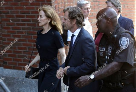 Felicity Huffman, William H. Macy. Felicity Huffman arrives at federal court with her husband William H. Macy for sentencing in a nationwide college admissions bribery scandal, in Boston
