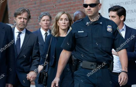 Felicity Huffman leaves federal court with her husband William H. Macy, left, and her brother Moore Huffman Jr. following, after she was sentenced in a nationwide college admissions bribery scandal, in Boston