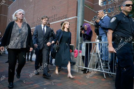 Felicity Huffman leaves federal court with her husband William H. Macy after she was sentenced in a nationwide college admissions bribery scandal, in Boston