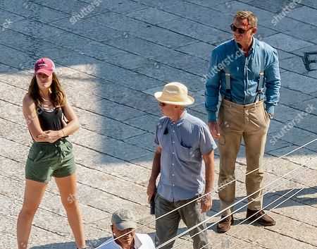 Stock Image of Actor Daniel Craig, right, is seen on the set of the latest James Bond movie 'No time to die' in Matera, southern Italy. The film is due out in spring 2020
