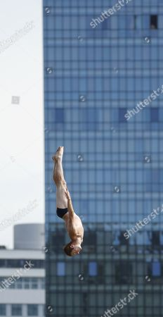 Stock Picture of Andy Jones of the US in action during the Cliff Diving World Series, celebrated in front of the Guggenheim museum in Bilbao, Spain, 13 September 2019. The Red Bull Cliff Diving World Series final, taking place on 13 and 14 September 2019, is the first one permitting women to compete.